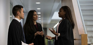 postgraduate law students having a discussion