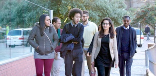 group of students walking towards the library