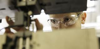 Apprentice using tooling equipment