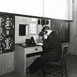 Image of man on telephone coal and community